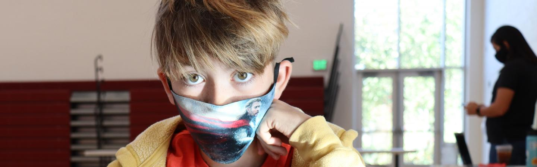 kid in mask inside