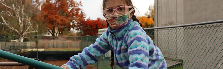 kid in mask outside